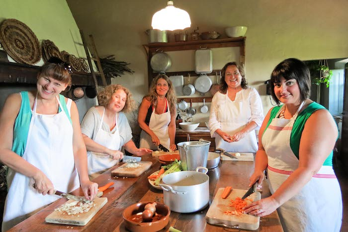 Women cooking during the Italian cooking class