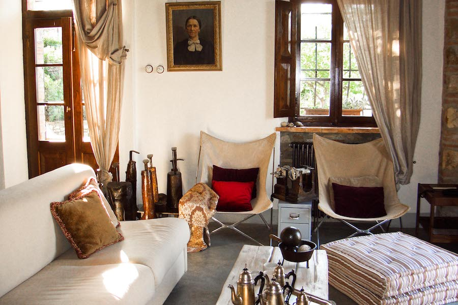 Modern sofa chairs among ancient tools