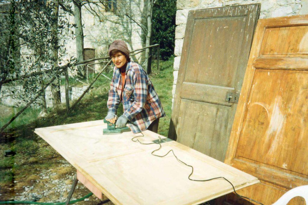 Elena restoring an old door