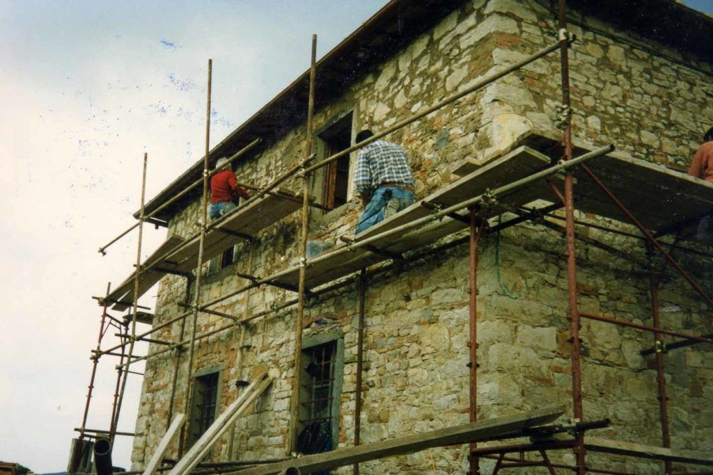 Men working to restore Borgo Argenina