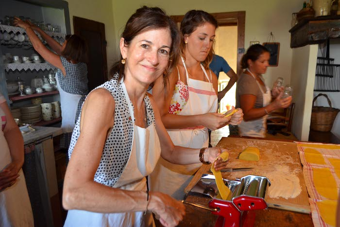 Women preparing home made pasta - cooking classes in Chianti Siena Tuscany