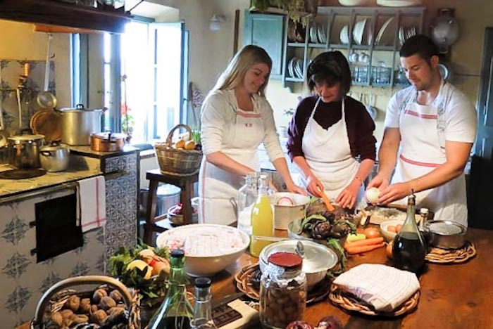 Honeymooners cooking together during the Italian cooking class - cooking classes in Chianti Siena Tuscany