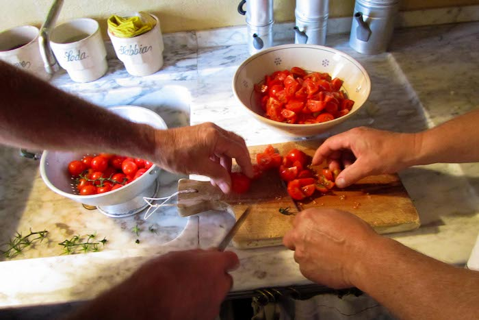 Chopping tomatoes during the Italian cooking class - cooking classes in Chianti Siena Tuscany